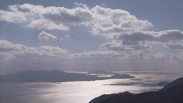Kitan Straits; Japan. Wide shot of coastal landscape. High angle of islands and oceans. Clouds blow overhead. Big Sky.