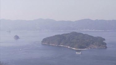 Kitan Straits; Japan. Wide shot high angle looking down at an island.
