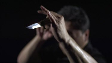 Man sparing with a knife_CU_Knife in focus_Slo Mo