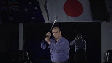 Man whelding Samuri sword_WS_Slo Mo