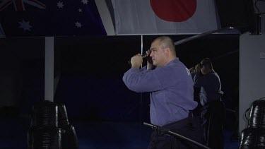 Man striking down with samuri sword_Profile_WS_Slo Mo