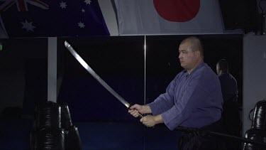 Man striking down with samuri sword_Profile_WS_Slo Mo_T2