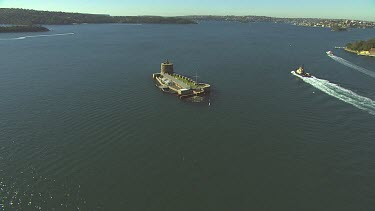 Fort Denison in Sydney Harbour. Also called Pinchgut. Relict of convict history. Water of harbour.
