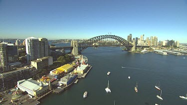 Sydney Harbour from North over Luna Park and Milson's Point, Kirribilli. Bridge with city CBD on rhs.