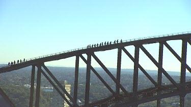 Sydney Harbour Bridge with tourists climbing bridge. Close Up.