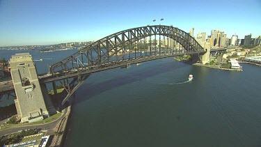 Sydney Harbour Bridge with city CBD. Medium shot.