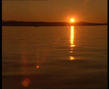 Beautiful sunset over Vancouver Island light reflecting off the water. Shot from boat