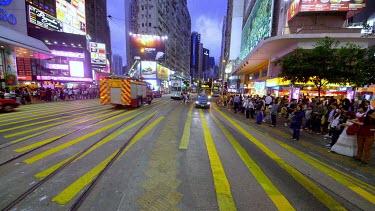 Buses, Trams & Pedestrians On Yee Wo Street, Causeway Bay, Hong Kong, China