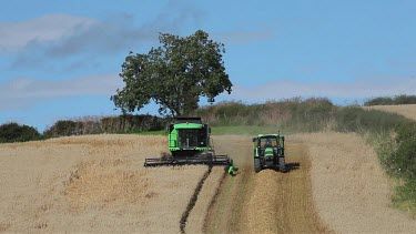 Tractor & Combined Harvester In Field, North Yorkshire, England