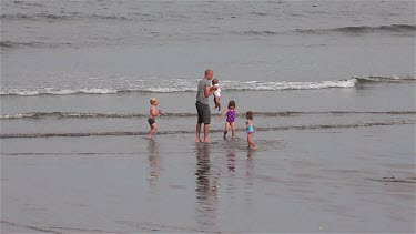 Children Playing In The Sea, Sandsend, North Yorkshire, England