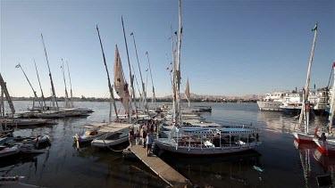 Moored Feluccas & Passenger Ferries, River Nile, Luxor, Egypt