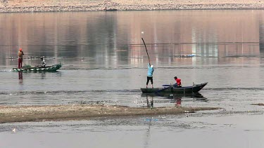 Fishermen On Rowing Boats Putting Out Nets, River Nile, Luxor, Egypt
