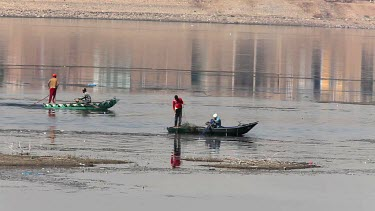 Fishermen On Rowing Boats Bringing In Nets, River Nile, Luxor, Egypt