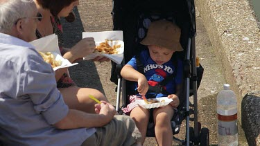 Young Boy Eating Chips From Tray, Bridlington, North Yorkshire, England