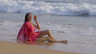 Model Sat In Indian Ocean Surf, Bentota, Sri Lanka